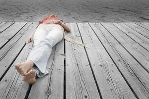 Woman lying on dock
